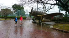 Checking out the Kamakasi plane outside the peace museum.