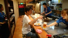 Chef prepares our fried noodle 'pancake' in Hiroshima.