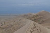 Sand mist from the top of the Singing Dunes