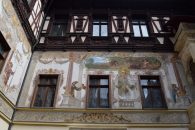 Frescoes inside courtyard at Peles castle