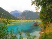 Issyk lake near Almaty. This natural lake was destroyed by mud slides in 1963. 100's died as they were there to see the Russian President, who was running late !  This news was suppressed at the time. In the late 90's dams were built to replace the original (now destroyed) earthquake plugs and the dam was resurrected (but smaller than the original).